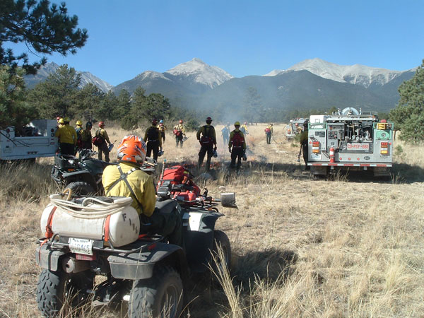 Federal, state and local firefighters prepare to ignite the Three Mile Prescribed Fire on U.S. Forest Service land next to the Mesa Antero Subdivision in October, 2007.